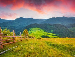 Colorful summer sunset in the Carpathian mountains. Cosarische ridge, Ukraine, Europe.