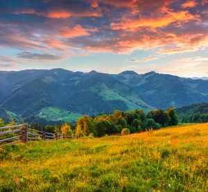 Colorful summer sunrise in the Carpathian mountains. Cosarische ridge, Ukraine, Europe.